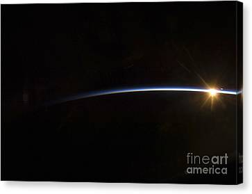 Sunrise As Viewed In Space Canvas Print by Stocktrek Images
