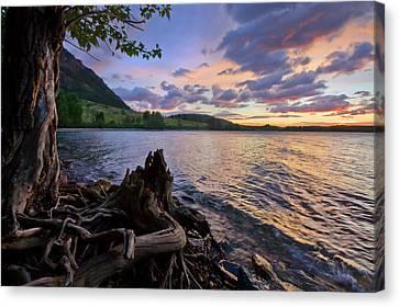 Canvas Print featuring the photograph Sunrise At Waterton Lakes by Dan Jurak