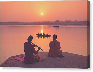 Sunrise By The Ganges Canvas Print by Marji Lang