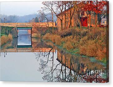 Sunrise On The I And  M Canal Canvas Print by Paula Guttilla