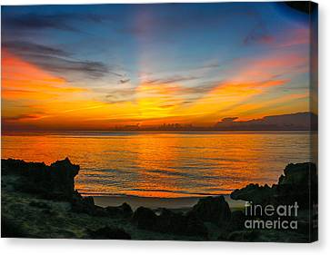 Sunrise On The Rocks Canvas Print by Tom Claud