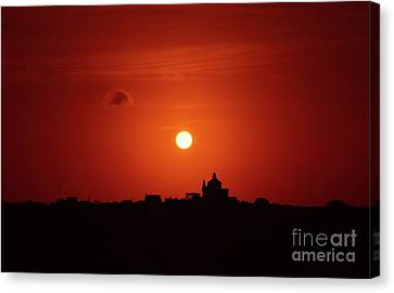 Sunrise Over A Small Town Canvas Print by Stephan Grixti