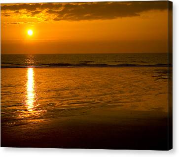 Sunrise Over The Ocean Canvas Print by Svetlana Sewell