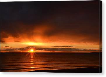 Sunrise Rays Canvas Print by Nancy Landry