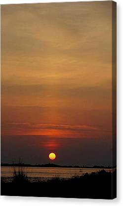 Sunrise With Buoy Canvas Print