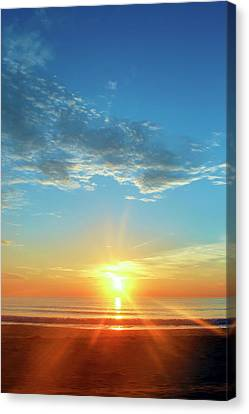 Sunrise With Flare Canvas Print by David Stasiak