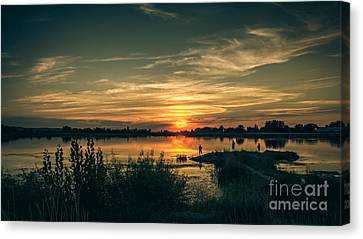 Sunset And Fishing Canvas Print by Robert Bales