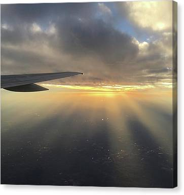 Sunset And Sun Rays From The Plane Canvas Print by Richard Bryce and Family