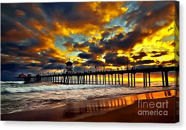 Sunset At Huntington Beach Pier Canvas Print by Peter Dang