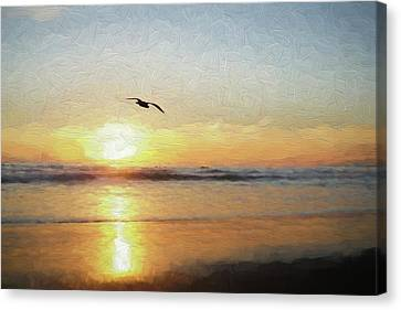Sunset At The Beach Canvas Print by Ernie Echols
