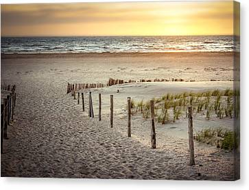 Canvas Print featuring the photograph Sunset At The Beach by Hannes Cmarits
