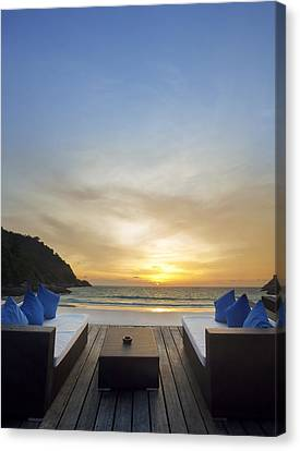 Sunset Beach Canvas Print by Setsiri Silapasuwanchai