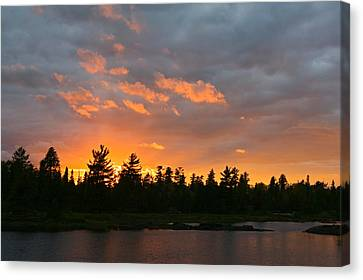 Sunset Behind Silhouetted Forest, Lake Canvas Print