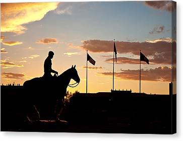 Sunset Behind Will Rogers And Soapsuds Statue At Texas Tech University In Lubbock Canvas Print by Ilker Goksen