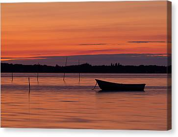 Sunset Boat Canvas Print by Gert Lavsen