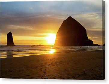 Sunset By Haystack Rock At Cannon Beach Canvas Print by David Gn