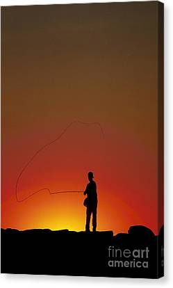 Sunset Casting Canvas Print by John Greim