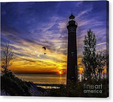 Sunset Flyer At The Light Canvas Print