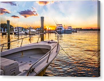 Sunset Harbor Canvas Print by Debra and Dave Vanderlaan
