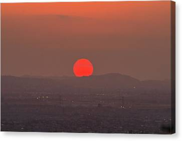 Sunset In Smog Canvas Print by Hyuntae Kim