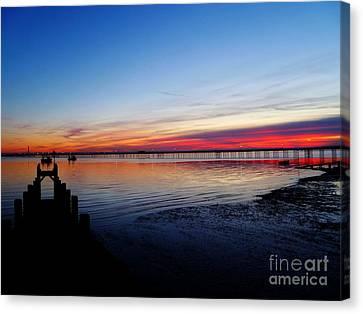 Sunset On The Shore Of Southend Canvas Print