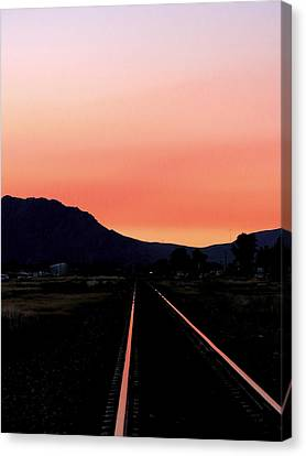 Sunset On The Tracks Canvas Print by Leah Grunzke