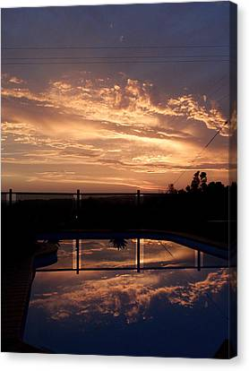 Sunset Over A Pool Canvas Print by Edan Chapman