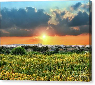 Sunset Over A Small Village Canvas Print by Stephan Grixti