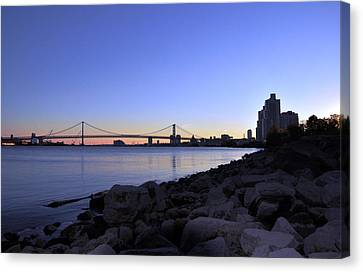 Sunset Over Ben Franklin Bridge Canvas Print by Andrew Dinh