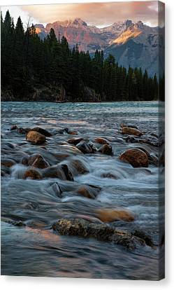 Canvas Print featuring the photograph Sunset Over Bow River In Banff National Park by Dave Dilli