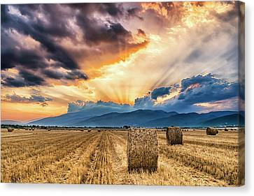 Sunset Over Farm Field With Hay Bales Canvas Print