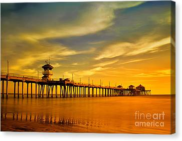 Sunset Over Huntington Beach Pier Canvas Print by Peter Dang