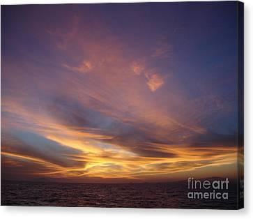 Sunset Over Island Canvas Print by Chad Natti