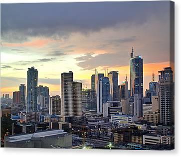 Sunset Over  Makati City, Manila Canvas Print by Neil Howard