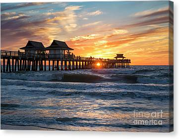Canvas Print featuring the photograph Sunset Over Naples Pier by Brian Jannsen