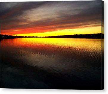 Sunset Over The Lake Canvas Print by Michelle Calkins