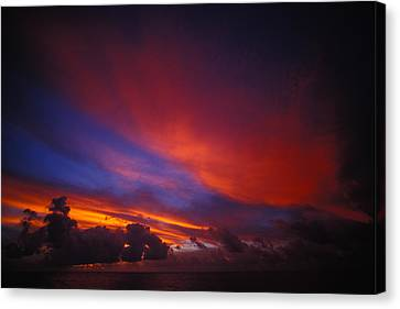 Sunset Over The Ocean Canvas Print by Nick Norman