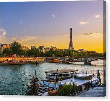 Sunset Over The Seine In Paris Canvas Print by James Udall