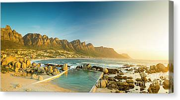 Sunset Panorama Of Camps Bay In South Africa Canvas Print by Tim Hester