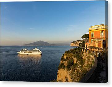 Sunset Postcard From Sorrento - The Sea The Cliffs And Vesuvius Volcano Behind The Criuse Ship Canvas Print by Georgia Mizuleva