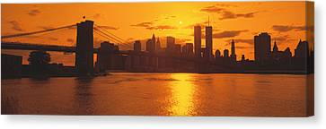 Sunset Skyline New York City Ny Usa Canvas Print by Panoramic Images