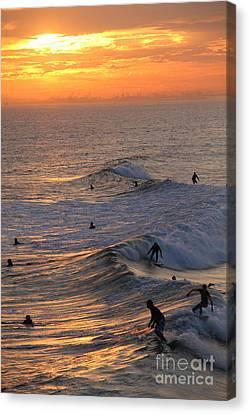 Canvas Print - Sunset Surfers Huntington Beach by Linda Queally