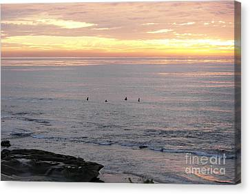 Canvas Print featuring the photograph Sunset Surfing by Carol  Bradley