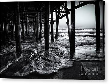 Sunset Under The Santa Monica Pier Canvas Print by Doug Sturgess