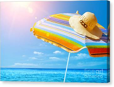 Sunshade And Hat Canvas Print by Carlos Caetano