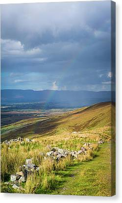 Canvas Print featuring the photograph Sunshine And Raining Down With Rainbow On The Countryside In Ire by Semmick Photo