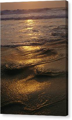 Surf On A Beach At Twilight Canvas Print by Raul Touzon