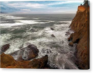 Surfer At Cape Kiwanda In Pacific City Canvas Print by David Gn
