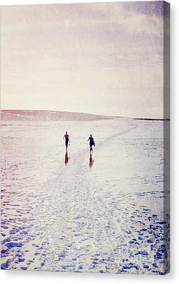 Canvas Print featuring the photograph Surfers In The Snow by Lyn Randle