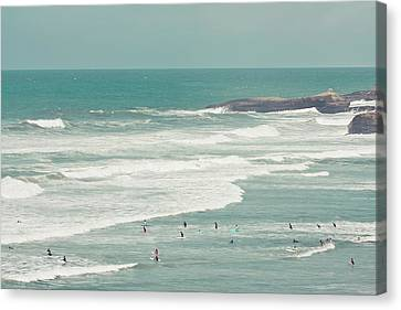 Surfers Lying In Ocean Canvas Print by Cindy Prins